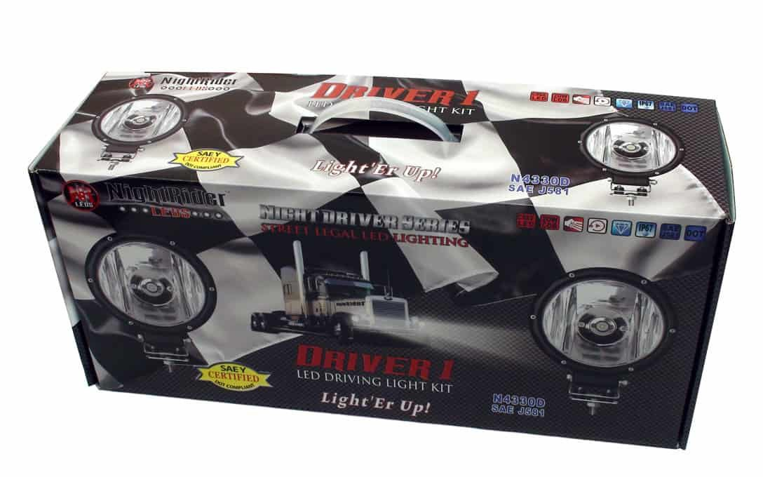 """Driver 1 - 7"""" Round SAE Driving Light Kit boxed up"""