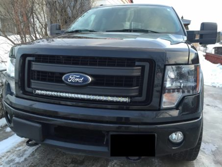 Black Ford F-150 with 30