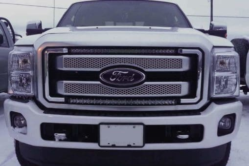 White Ford Super Duty with 2 x 30 inch Extreme Series Curved Single Row Light Bars (NLPCR315)