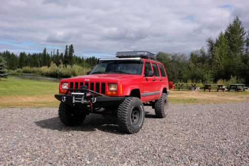 Red Jeep Cherokee with Extreme Series Single Row Light Bars