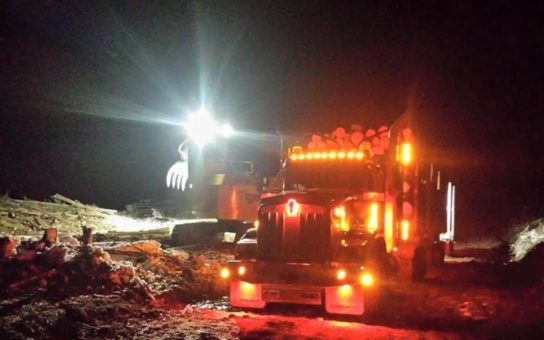 Madill Loader with Rider Series Double Row Light Bars at Work at Night