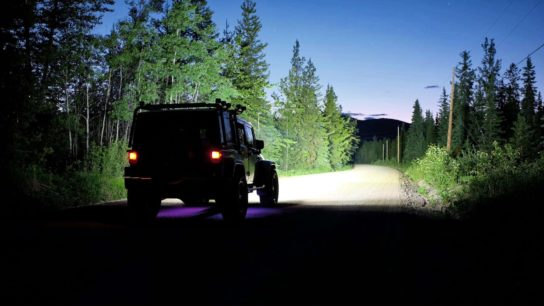 NightRider Jeep on dirt road lighting up the night very bright very far