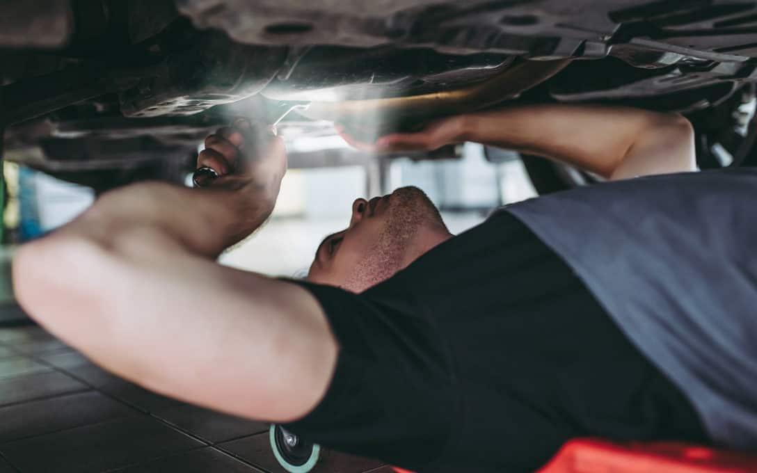 Mechanic using Headlamp