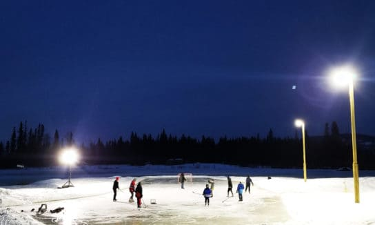 NightRider™ Commercial LED Shoe Box Lights facilitate a game of nighttime pond hockey
