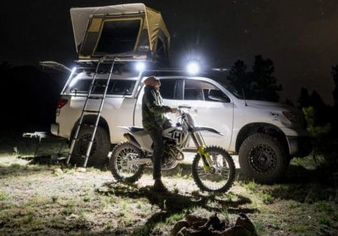 Cube flood lights mounted on truck roof rack and rooftop tent